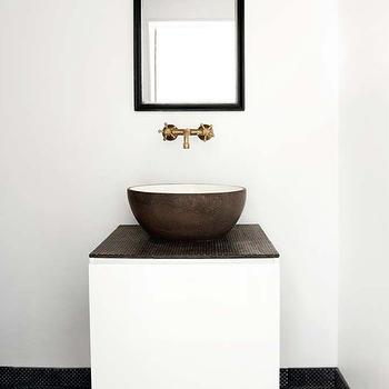 Made a Mano - bathrooms - modern bathroom, black and white bath, black and white bathroom, black and gold mirror, lavastone tiles, black lavastone tiles, lava stone tiles, black lava stone tiles, black terracotta tiles, black terracotta floor, round vessel sink, round stone sink, gold faucet, floating vanity, floating washstand,