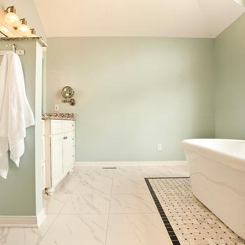 CASE Design and Remodeling - bathrooms - blue walls, blue wall color, blue bathroom walls, marble tiled floors, marble tile, marble floor tiles, basketweave marble tile floors, basketweave marble tile, tiled bath rug, freestanding tub, freestanding bath, freestanding bathtub, tub filler, floor mount faucet, bath under window, tub under window, wall hooks, towel hooks, white towels, ivory sink vanity, blue green paint colors, bathroom paint colors, basketweave inset tiles,
