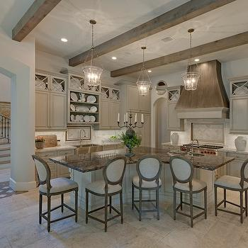 Stunning kitchen with glazed gray cabinets accented with nickel pulls alongside ...
