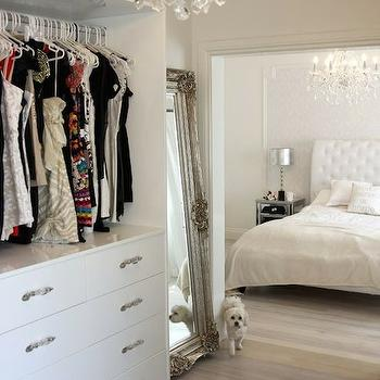 closets - master bedroom, white master bedroom, framed wallpaper, wallpaper accent wall, damask wallpaper, white damask wallpaper, sleigh headboard, white sleigh headboard, mirrored nightstand, baroque mirror, baroque floor mirror, master bedroom closet,