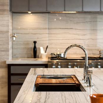 Calcutta Macaubas Quartzite With Backsplash For An Off White Kitchen