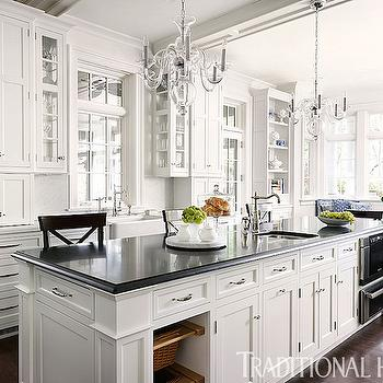 Traditional Home - kitchens: white kitchen, shaker kitchen, nickel latch hardware, appliance cabinet, small appliance cabinet, narrow glass front cabinets, slim glass front cabinets, farm sink, farmhouse sink, hook spout faucet, kitchen island prep sink, island prep sink, pull out storage bins, pull out island bins, warming drawer, microwave in kitchen island, kitchen island warming draw, glass chandelier, kitchen island chandelier, island chandelier, white marble counter, solid marble backsplash, seamless marble backsplash, black counter, black countertop, transom window, transom over window, black counter stool, black x back counter stool, x back counter stool, island bins, kitchen island bins, island warming drawer, island microwave, pull out microwave, warming drawer in island, microwave in island, long kitchen island, x back barstools, black x back barstools,