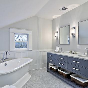 Avenue B - bathrooms - Benjamin Moore - Horizon - sloped ceiling, angled ceiling, sloped bathroom ceiling, bathroom sloped ceiling, bathroom angled ceiling, sloped ceiling bathroom, angled ceiling bathroom, gray walls, gray wall color, gray bathroom walls, board and batten, board and batten trim, bathroom board and batten, gray bathroom vanity, gray double vanity, gray sink vanity, gray bathroom, dual sinks, italian carrara marble counter, italian carrara marble countertop, nickel vanity mirror, polished nickel wall sconce, rectangular polished nickel wall sconce, polished nickel wall sconce with frosted shade, window trim, small bathroom window, angled tub, pedestal tub, angled pedestal tub, angled bath, angled freestanding bath, corner freestanding tub, corner freestanding bathtub, modern floor mount faucet, modern tub filler faucet, towel rack, towel bar, towel rail, bath in corner, tub in corner, bath on angle, pedestal bath, gray dual sink vanity, gooseneck faucet, towel ring, gray sink vanity with drawers, sink vanity with shelf, woven baskets, marble herringbone tiled floors, marble herringbone bathroom floor, bianco carrara marble tiled floors, bianco carrara marble floor tile, bianco carrara marble herringbone tile, corner bathtub,