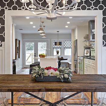 Avenue B - dining rooms: black and white geometric wallpaper, geometric wallpaper, wallpapered half wall, batten and board half wall, batten and board trim, batten and board wainscoting, batten and board, modern white chandelier, industrial dining table, wooden dining table with iron base, iron based wood dining table, see through dining chairs, acrylic dining chairs, black and white chain link wallpaper, chain link wallpaper, black and white wallpaper, white candelabra chandelier, white chandelier, black and white dining room, restoration hardware dining table, salvaged wood dining table, reclaimed wood dining table, dining room wallpaper, wallpaper for dining rooms,
