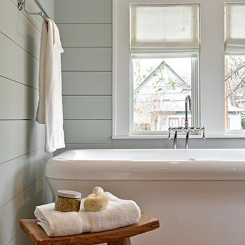 Avenue B - bathrooms - Benjamin Moore - Tranquility - white sheers, white sheer roman shade, shiplap clad walls, shiplap wainscoting, bathroom shiplap, horizontal wood paneling, wood paneled bathroom walls, pedestal tub, pedestal bath, pedestal bathtub, bath under window, tub below window, floor mount faucet, floor mount tub filler, tub filler faucet, zen stool, rustic wooden stool, bathroom stool, chrome towel rail, chrome towel bar, window trim, window molding, gray green walls, gray green wall paint, gray green paint colors,