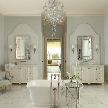 The Iron Gate - bathrooms - french bathrooms, white and blue bathrooms, bathroom chandeliers, curved backsplash, curved vanity backsplash, curved washstand backsplash, waterworks sconces, etched mirrors, his and her vanities, his and her washstands, separate vanities, separate washstands, freestanding bathtub, pedestal bathtubs, bathroom tables, floor mounted tub filler, tub fillers, blue french chair, bathroom chairs, bathtub chandelier,