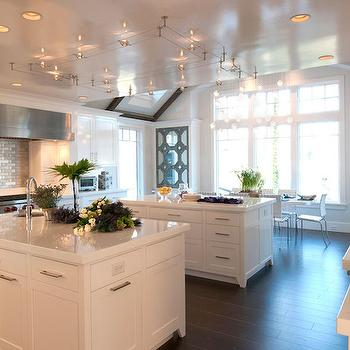 Stunning kitchen features contemporary, concentric track lighting illuminating ...