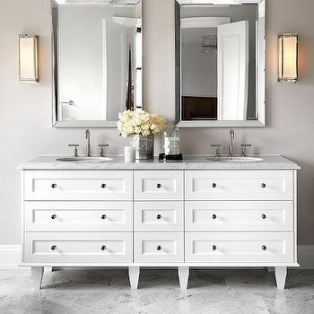 The Design Company - bathrooms - white and gray bath, white and gray bathroom, beveled mirror, beveled vanity mirror, vanity sconces, double washstand, white double washstand, dresser washstand, dresser like washstand, dresser like sink vanity, his and her sinks, marble counter, marble floor,