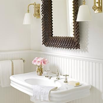 House Beautiful - bathrooms - cottage bath, cottage bathroom, basketweave mirror, vanity sconces, brass vanity sconces, pedestal sink, powder room, powder room sink, powder room, mirror, mirrors for powder rooms, powder room beadboard, beadboard powder room, paneled powder rooms,