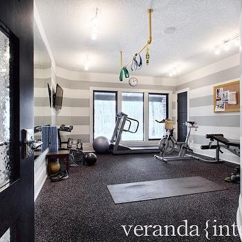 Veranda Interiors - media rooms: home gym, home gym room, gym room, track lighting, seeded glass black door, black interior door, seeded glass door, gray and white striped walls, horizontal striped walls, gray and white horizontal striped walls, gray floors, ceiling mount pull up bar, ceiling mounted pull up bar, home gym ideas,