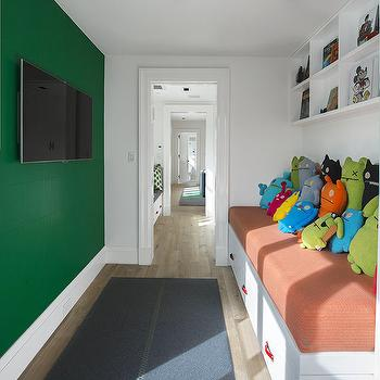 Morris and Woodhouse - boy's rooms - kids room, long kids room, kids tv room, green accent wall, kids tv, daybed, kids daybed, white daybed, red leather pulls, boys daybeds, built in cubbies, kids cubbies, over the bed cubbies,