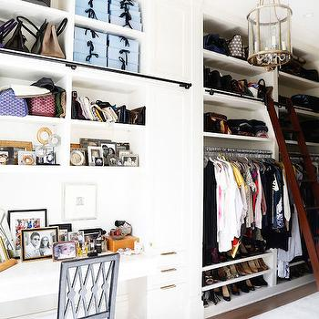 House Beautiful - closets - long closet, long walk in closet, closet ladder, closet ideas, chic closets, closet lanterns, closet lighting, floor to ceiling builtins, built ins, built in cabinets, built in cubbies, closet built ins, closet built in cabinets, closet built in cubbies, handbag storage, purse storage, how to store bags, how to store purses, shelves for shoes, shoe shelves, closet vanity, closet make up vanity, make up vanity, built in make up vanity, built in dressing table, shelves for bags, shelves for purses,