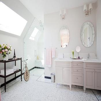 HGTV - bathrooms - Behr - Silver Drop - elegant bathrooms, sophisticated bathrooms, sloped ceiling, bathroom sloped ceiling, seamless glass shower, shower bench, sunny bathrooms, his and her mirrors, oval mirrors, vanity mirror, oval vanity mirror, double sink vanity, double washstand, gray double vanity, gray double sink vanity, gray double washstand, white quartz counters, white quartz countertops, organic white quartz, organic white quartz countertops, caesarstone organic white, caesarstone organic white counters, caesarstone organic white countertops, mosaic marble floor, bathroom console table, 2 tier console table, 2 shelf console table,
