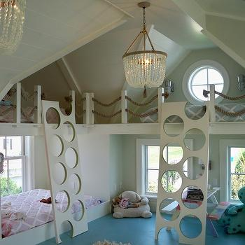 Andra Birkerts Design - girl's rooms - attic bunk room, dormer bunk beds, dormer ceilings, attic ceilings, wood planked attic ceiling, wood paneled attic ceiling, beaded chandelier, clear beaded chandelier, rope bunk bed railing, built in bunks, built in bunk beds, wraparound built in bunk beds, bunk room, bunk room ideas, kids bunk room, round window, round attic window, painted floors, turquoise painted floors, shag rug, kids picnic table, picnic style play table, pink trellis bedding, blue trellis bedding, pink diamond trellis bedding, blue diamond trellis bedding, modern bunk bed ladder, bunk bed ladder with round treads, bunk bed ladder with round cut out treads, bunk bed ideas, attic bunk room ideas, attic kids room, bunk bed ladders, unique bunk bed ladders, rope railing, beaded chandelier,