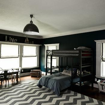 Paloma Contreras - boy's rooms - black bunk beds, black and white roman shades, grosgrain roman shades, toy basket, industrial toy basket, toy storage, rolling toy storage, play table and chairs, chevron rug, kids rugs, gray chevron rug, navy walls, navy paint colors,