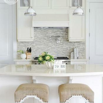 Stunning kitchen features ivory cabinets paired with ivory countertops and stone ...