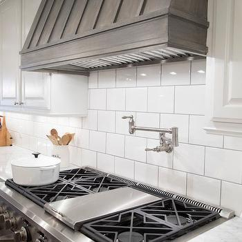 HGTV - kitchens - carrera marble, carrera marble countertops, carrera countertops, carrera counters, pure white cabinets, pure white kitchen cabinets, large subway tiles, kitchen subway tiles, kitchen with subway tiles, wood kitchen hood, wood range hood, wood exhaust hood, stained wood kitchen hood,