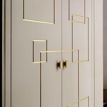 closets - gray doors, bi fold doors, closet doors, gray closet doors, gray bi fold doors, greek key trim, gold greek key trim, door trim, gold door trim,