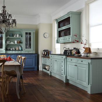 kitchens - deep crown molding, wooden counters, butcher block counters, dark stained wood counter, dark wooden countertop, raised sink counter, raised sink countertop, hook spout faucet bridge hook spout faucet, built in plate rack, kitchen plate rack, built in kitchen hutch, kitchen hutch, two toned china hutch, two tone kitchen, blue kitchen, blue kitchen cabinets, blue kitchen cabinets, cottage kitchen, cornflower blue kitchen cabinets, duck egg blue kitchen cabinets, duck egg blue cabinetry, brushed nickel cabinet pulls, brushed nickel hardware, black chandelier, black crystal chandelier, kitchen chandelier, eat in kitchen, gray dining table, cabriole leg dining table, gray cabriole leg dining table, french cafe dining chair, french cafe side chair, dining table in kitchen, cottage kitchen, built in hutch, china hutch, built in china hutch, cornflower blue cabinets, duck egg blue cabinets, cabriolet dining table, gray dining table, gray french dining table,
