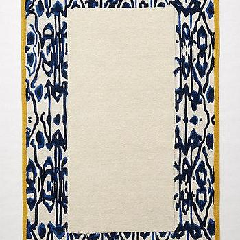 Rugs - Ikat Border Rug I anthropologie.com - ikat bordered rug, blue and mustard yellow ikat rug, blue and yellow ikat bordered rug, rug with ikat border,