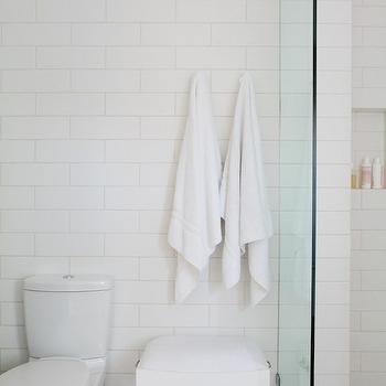 Bestor Architecture - bathrooms - walk in shower, walk in shower ideas, arctic white tiles, daltiles, daltile arctic white, carrera marble shower floor, carrera shower floor, carrera subway tile, shower partition, glass shower partition, bathroom bench, towel hooks, toto toilet, dual flush toilet, bathroom stool,