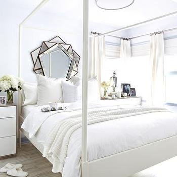 HGTV - bedrooms - white and blue bedrooms, chic bedrooms, light blue walls, light blue bedroom walls, canopy bed, poster bed, white canopy bed, white poster bed, ikea bed, ikea canopy bed, ikea poster bed, sunburst mirror, white and ivory bed linens, white and ivory bedding, 2 tone nightstand, 3 drawer nightstand, 3 drawer chest, ikea nightstand, ikea dresser, mercury glass lamp, urn table lamp, antiqued sunburst mirror, layered window treatments, ivory roman shades, white drapes,