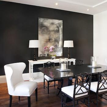 Jessica Glynn - dining rooms - black and white dining room, chic dining rooms, black accent wall, dining room accent wall, antiqued mirrors, dining room mirror, black dining table, faux bamboo chairs, faux bamboo dining chairs, black dining chairs, black bamboo dining chairs, captain dining chairs, white wingback dining chairs, wingback captain dining chairs, black and white curtains, banded curtains, banded drapes,
