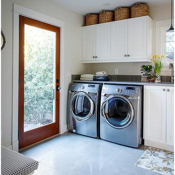 The House Diaries - laundry/mud rooms - laundry baskets, shaker cabinets, laundry room cabinets, cabinets over washer dryer, cabinets over washer and dryer, gray quartz counters, gray quartz countertops, front load washer dryer, porcelain tiles, semi polished tiles, semi polished porcelain tiles,