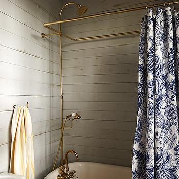 Garden and Gun - bathrooms - cottage baths, paneled baths, gray wall panels, gray wall paneling, horizontal wall paneling, gray bathroom panels, gray claw foot tub, brass shower kit, brass shower rail, floral shower curtain, blue shower curtain, indigo shower curtain, indigo blue shower curtain,