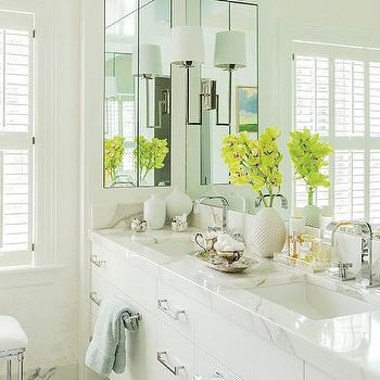 New England Home - bathrooms - wall length vanity mirror, frameless vanity mirror, vanity length mirror, vanity mirror with inset sconces, mirror inset sconces, white calacatta marble, white calacatta marble counters, dual sinks, his and hers sinks, polished nickel pulls, modern nickel drawer pulls, white vanity, modern white vanity, floating white sink vanity, lucite towel bar, blue towels, rectangular sink, porcelain sink, modern faucet, polished chrome faucet, plantation shutters, bathroom shutters, white bathroom vanity, modern built in bathroom vanity, lucite towel holder,