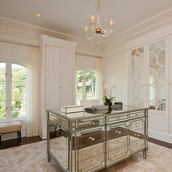 closets: dressing rooms, dressing room ideas, built ins, closet built ins, mirrored doors, mirrored closet doors, mirrored closet island, closet island, closet chandelier, arched windows, ivory sheers, ivory sheer curtains, closet built in cabinets, wardrobe cabinets, built in wardrobe cabinets,