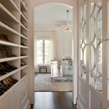 closets: dressing rooms, dressing room ideas, shoe shelves, shelves for shoes, built ins, closet built ins, built in shoe shelves, built in shelves for shoes, mirrored doors, mirrored closet doors, mirrored closet island, closet island, closet chandelier, arched windows,