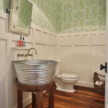Stacye Love - bathrooms - Sherwin Williams - Pearly White - board and batten, powder room board and batten, green and white wallpaper, green and white damask wallpaper, green damask style wallpaper, powder room wallpaper, hardwood floors, powder room wood floors, wall mount faucet, vintage style wall mount faucet, hand soap ledge, hand soap shelf, pivot mirror, beveled pivot mirror, pivot vanity mirror, galvanized tub sink, galvanized metal sink, galvanized tub sink on stand, board and batten powder room, green damask wallpaper, tub sink, tub vanity sink, galvanized sink,