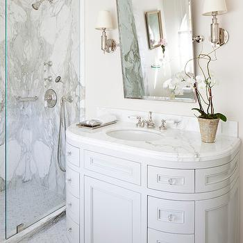 Smith Firestone Associates - bathrooms - curved vanity, curved sink vanity, curved washstand, rectangular mirror, pivot mirror, rectangular pivot mirror, marble hex tiles, marble hex floor, seamless glass shower, walk in shower, marble slab shower, marble slab shower surround,