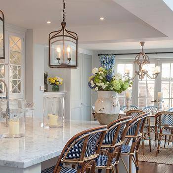 Chic cottage kitchen boasts tray ceiling Pottery Barn Gothic Lanterns illuminating ...
