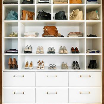Amory Brown - closets - built in closet, shoe storage, shoe display, closet shoe display, purse storage, closet purse storage, shoe shelving, floating shoe shelves, floating purse shelves, built in dresser drawers, white pulls with brass trim, brass trimmed drawer pulls, custom closet storage, built in purse cubbies, built in shoe cubbies, modern closet solutions, modern closet ideas, chic closet, bag display cabinet, handbag display cabinet,