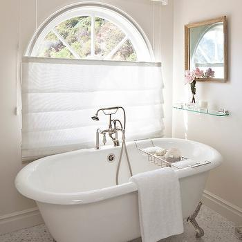 Smith Firestone Associates - bathrooms: elegant bathrooms, sophisticated bathrooms, marble hex floor, marble hex tiles, claw foot tug, silver footed claw foot tub, vintage glass shelf, beveled mirror, arched mirror, pleated valance, bathroom valance,