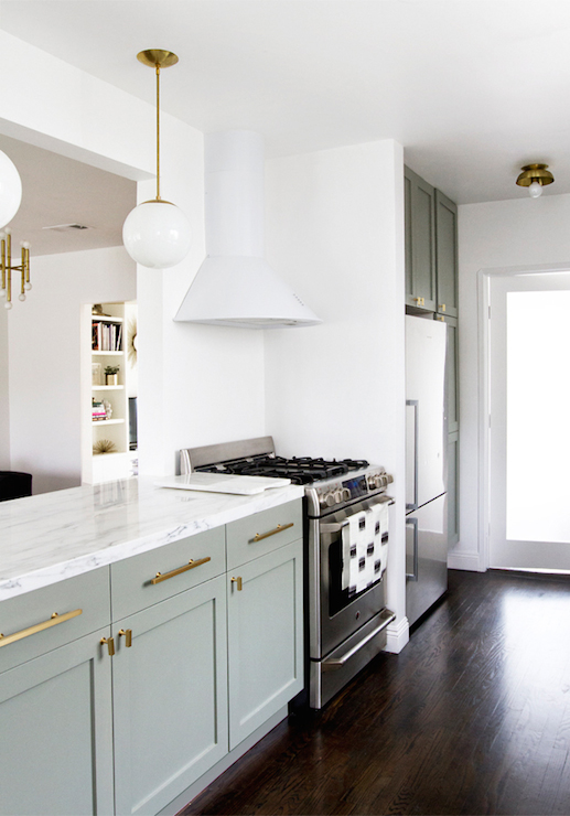 cabinets gray lower cabinets dark hardwood floors farmhouse sink gold