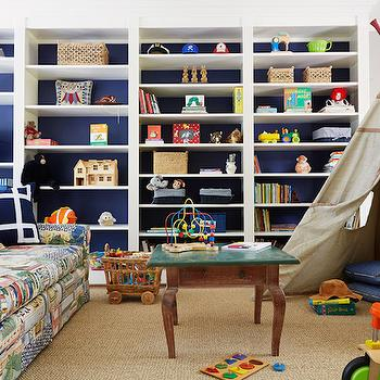 Suellen Gregory - boy's rooms - playroom, playroom ideas, play room, play room ideas, kids playroom, boys playroom, boys playroom ideas, kids playroom ideas, wall of built ins, built in shelves, floor to ceiling built ins, painted backs of shelves, play teepee, teepee, tipi, playroom table, patchwork sofa, roll arm sofa, rolled arm sofa,