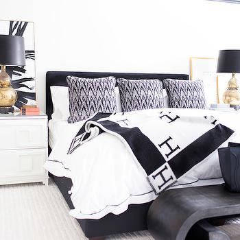 Alexis Bednyak Design - bedrooms - black and white rooms, black and white bedroom, cornice box, black and white cornice box, black and white curtains, black and white drapes, black and white drapery, black and white blanket, hermes blanket, avalon blanket, black and white hermes blanket, black bed, black headboard, tribal pillows, black and white bedding, black bench, greek key nightstands, white greek key nightstands, greek key chests, white lacquer chests, gold table lamps, gold gourd lamps, abstract art, black and white abstract art,