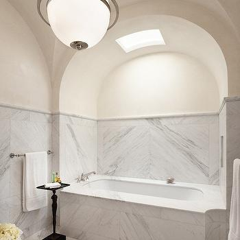 Mohon Imber - bathrooms - bathtub step, tub alcove, bathtub alcove, bath alcove, bathroom alcove, barrel ceiling, skylight bathroom skylight, skylight bathroom, skylight, cream walls, marble backsplash, marble clad walls, marble clad bathtub, bathroom table, elegant bathrooms,