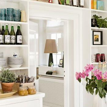 kitchens - built ins over door, built ins around door, built in shelving over doorway, built in shelving around door, shelves around door, kitchen built ins, built in kitchen shelving, glossy white door, brass door knob, white kitchen built ins, doorway shelves, doorway built ins,