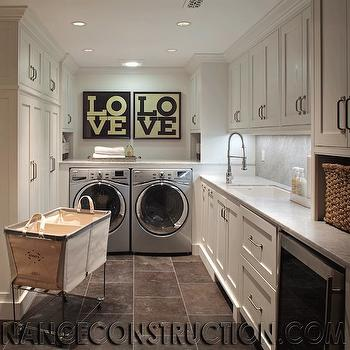 Nance Construction - laundry/mud rooms - laundry room, laundry room cabinets, laundry room sink, laundry room cabinets, honed marble, honed marble countertops, honed marble backsplash, off set faucet, laundry art, laundry room art, love art, silver washer and dryer, laundry hamper, laundry room hamper, laundry sorter, rolling laundry sorter, laundry room wine cooler, laundry room wine fridge,