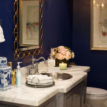 Pink Peonies - bathrooms: navy paint colors, navy wall paint, navy wall paint, navy blue paint, navy blue paint colors, navy blue wall paint, navy bathroom walls, maritime sconces, gold chain link mirror, oval chain link mirror, gold oval chain link mirror, gray washstand, gray vanity, gray sink vanity, white marble countertop, round vanity sink, metal vanity sink, hook spout faucet, ginger jar,
