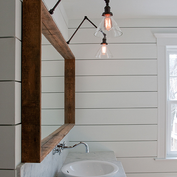 Sabbe Design - bathrooms: wood framed mirror, marble backsplash, marble countertops, wall mounted faucet, gray bath vanity, shallow vessel sink, vessel sink, vanity vessel sink, swing arm sconces, bathroom sconces, bathroom swing arm sconce, swing arm sconce bathroom,