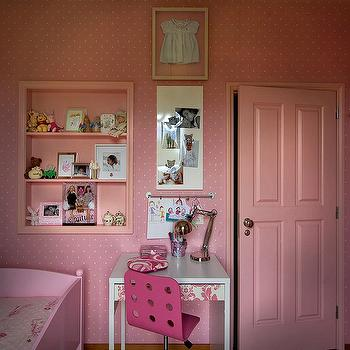 Maria Barros - girl's rooms - framed clothes, framed kids clothes, pink kids room, pink girls room, polka dot wallpaper, pink polka dot wallpaper, pink niche, kids room niche, kids desk, white desk, white lacquer desk, papered drawer front, white and pink desk, hot pink desk chair, hot pink task chair, pink door, 4 paneled door,