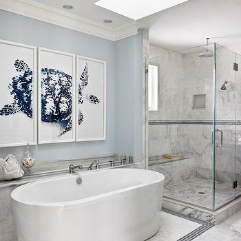 Christine Huve Interior Design - bathrooms - skylights, bath skylight, skylight bathroom, bathroom skylights, bathroom art, triptych art, turtle art, turtle triptych, blue walls, blue paint colors, blue wall paint, blue bathrooms, blue bathroom ideas, white and blue baths, white and blue bathrooms, oval bathtub, oval freestanding bathtub, freestanding bathtub, marble floor, blue mosaic tiles, blue floor tiles, blue border tiles, border floor tiles, corner shower, seamless glass shower, marble shower surround, rain shower head, marble shower bench, blue benjamin moore paint colors,