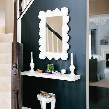 JWS Interiors - entrances/foyers - black accent wall, black foyer wall, foyer accent wall, entry accent wall, ballard designs mirror, scalloped mirror, white scalloped mirror, floating table, white floating table, floating console table, floating entry table,