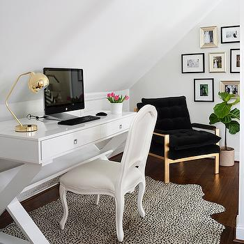 JWS Interiors - dens/libraries/offices: black velvet chair, black tufted chair, milo baughman chair, milo baughman, black chair, black armchair, art wall, fiddle leaf fig, sloped ceiling, home office, home office ideas, white lacquer desk, lacquered desk, x base desk, x based desk, white x base desk, white x based desk, white desk chair, french desk chair, cheetah rug, gold and black chair, black milo baughman chair,