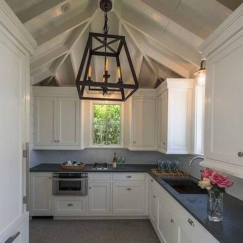 Brooks & Falotico - kitchens: truss ceiling, open truss ceiling, iron lantern, kitchen lanterns, white kitchen cabinets, honed black countertops, black countertops, under the counter microwave, pull out microwave,